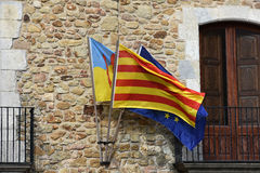 Pals. Detail of facade with catalan and european  flag  in the  small medieval  mediterranean village of Pals , near the coast of Costa Brava., Spain Royalty Free Stock Photo