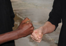 Pals and their fist-bump. Stock Photography