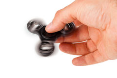 Palying with a Black Fidget Spinner Stock Photo