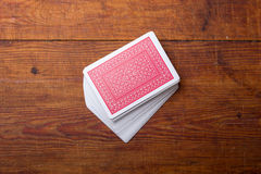 Palying cards on wooden table Royalty Free Stock Photos