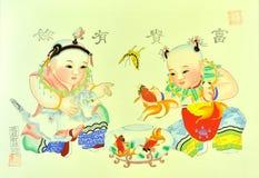 palying traditionell printingstil för kinesisk unge Arkivbild