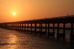 Pamban bridge against the rising sun Royalty Free Stock Image