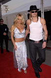 Pamela Anderson,Kid Rock. Actress PAMELA ANDERSON & boyfriend KID ROCK at the American Music Awards in Los Angeles. 09JAN2002.   Paul Smith/Featureflash Royalty Free Stock Photos