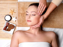 Pamering and massage for face of woman stock images