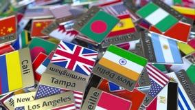 Pamiątkarski magnes lub odznaka z Dhaka flagą państowową wśród różnych ones i tekstem Podróżować Bangladesz konceptualny zbiory wideo