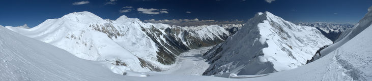 Pamir glacier. Panoramic shot of the Dzerzhinsky glacier from above Royalty Free Stock Image