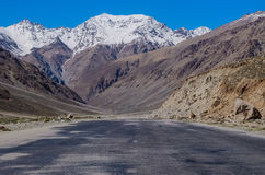 The Pamir Highway. This dusty and desolate stretch of road runs through the Pamir mountains in Central Asia Royalty Free Stock Image