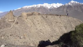 Pamir Highway Yamchun Fort. Ruins Wakhan Corridor View with Snow Capped Mountains at Background on a Sunny Blue Sky Day stock video