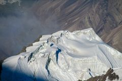 Pamir mountains snow ice peaks cold view. Pamir mountains snow peaks panorama Kyrgyzstan close to Lenin Peak base camp. Cold high snow mountains and glacier stock photos