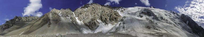 Pamir mountains snow peaks long panorama. Pamir mountains snow peaks panorama Kyrgyzstan close to Lenin Peak base camp royalty free stock photography