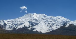 Pamir mountains snow peaks long panorama. Pamir mountains snow peaks panorama Kyrgyzstan close to Lenin Peak base camp stock photo
