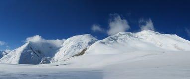 Pamir mountains cold snow ice glacier long panorama stock photo