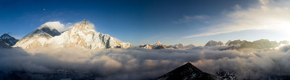 A Pamoramic View of Everest and Nuptse. A panoramic view of Everest and the formidable West face of Nuptse at sunset, taken from Kala Patthar Stock Images