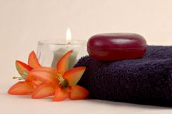 Pamper. Luxury soap, candles, and flowers in a day spa setting royalty free stock photos