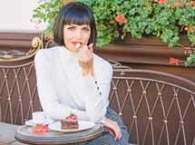 Pamper yourself. Girl relax cafe with cake dessert. Gourmet concept. Pleasant time and relaxation. Delicious gourmet. Cake. Woman attractive elegant brunette royalty free stock photo