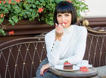 Pamper yourself. Girl relax cafe with cake dessert. Gourmet concept. Pleasant time and relaxation. Delicious gourmet. Cake. Woman attractive elegant brunette stock photo