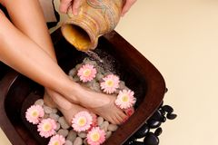Pampered feet pedispa. A woman enjoys a soothing foot spa pedispa Royalty Free Stock Photos