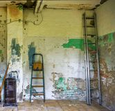 Pampered room in a neglected ugly house with flaking paint on th Stock Photography
