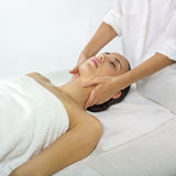 Pampered young woman. With female hands doing a massage Stock Photos