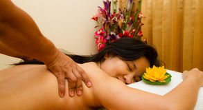 Pampered young woman with a massage.  Royalty Free Stock Image