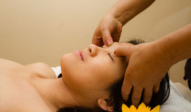 Pampered young woman with a massage.  Royalty Free Stock Photos