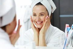 Pampering eye cream Stock Images