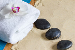 Pampering therapy at the beach with hot stone massage Stock Photos