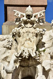 Pamphilj  Papal coat of arms from Fountain of Four Rivers in Rom. Detail of Fountain of Four Rivers with Pamphilj Papal coat of arms (17th century Royalty Free Stock Photo