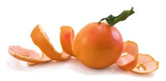Pamplemousse et longue peau de pamplemousse. Photo stock