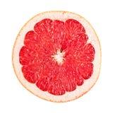 Pamplemousse rouge coupé en tranches sur le blanc Images stock