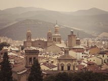 Pamplona on the background of mountains. Panoramic view of Pamplona on the background of mountains. Retro toned. Navarre, Spain Stock Photography