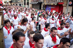 PAMPLONA, SPAIN - JULY 8: People await start of race of bulls at Stock Images