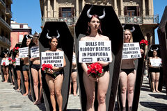 PAMPLONA, SPAIN - JULY 5: People protesting against cruelty to a Royalty Free Stock Image