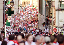PAMPLONA, SPAIN -JULY 9: People run from bulls on street Santo D Royalty Free Stock Image
