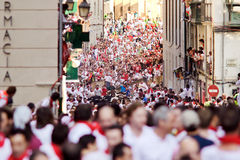 PAMPLONA, SPAIN -JULY 9: People run from bulls on street Santo D Stock Photos