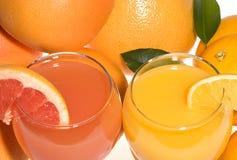 Pamplumossa e sumo de laranja frescos Imagens de Stock