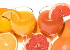 Pamplumossa e sumo de laranja frescos Imagem de Stock