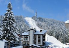 PAMPOROVO, BULGARIA - MARCH 11, 2015 : Winter resort with ski lift and ski tracks and the Snejanka tower stock images