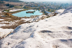 Pamukkale lake and town. Lake of natural park Pamukkale and town, panoramic view of lake and town from hot spring mountain in Denizli province in southwestern Royalty Free Stock Photo