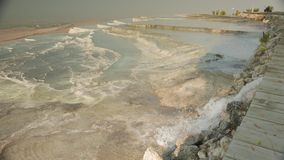 Pamukkale mineral hot springs with calcium terraces, Turkey. 4k. Pamukkale natural sightseeing of mineral hot water with limestone terraces, Denizli, Turkey. 4k stock video