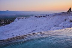 Pamukkale`s carbonated travertines at dusk. Pamukkale carbonated pools are empty at dusk Stock Photos