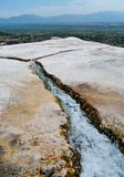 Pamukkale springs. Irrigation ditch from the World Heritage Site of Hierapolis-Pamukkale (Turkey), with the natural terraces of sedimentary carbonate minerals Stock Photography