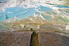 Pamukkale terraces. Pamukkale natural hot springs and terraces made of calcium carbonate minerals or travertines in Denizli province of southwestern Turkey Royalty Free Stock Photography