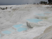 Pamukkale Travertines. Pamukkale, Turkey - January 2012 : Pamukkale, meaning cotton castle in Turkish, is a natural site in Denizli Province in south-western Royalty Free Stock Photography