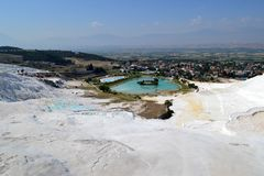 Pamukkale in Turkey. Pamukkale in Denizli Province in southwestern Turkey. The snow-white brittle rock and blue water. Photo taken on: May 28 Wednesday, 2014 Royalty Free Stock Photo