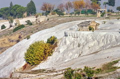 Ruins of Hierapolis city - landmark attraction in Pamukkale, Turkey. Landscape. Famous terraces with the ancient ruins of Hierapolis city - landmark attraction Royalty Free Stock Image