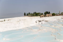 Pamukkale, Turkey. Landscape with beautiful travertine terraces and ruins of ancient city Royalty Free Stock Photos