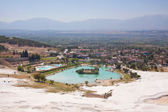 Pamukkale. Turkey. Mountain slope with travertine and valley with lake Stock Photos