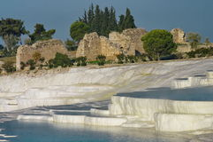 Famous terraces and ruins - Pamukkale, landmark attraction in Turkey. Overview in the Pamukkale, landmark attraction in Turkey. Famous terraces and ruins Royalty Free Stock Photography