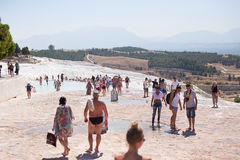 PAMUKKALE, TURKEY - September 13, 2015: Tourists regard the travertines with pools and terraces at Pamukkale.. Pamukkale is included in the UNESCO World Stock Image